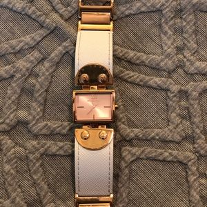 Micheal Kors rose gold and white watch.